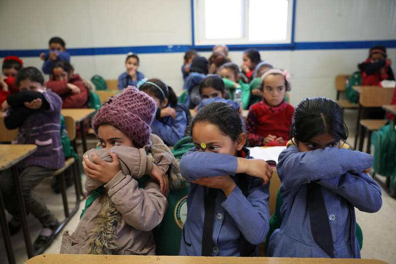 Syrian refugee students take part in a washing hands activity during an awareness campaign about coronavirus initiated by OXFAM and UNICEF at Zaatari refugee camp in the Jordanian city of Mafraq, near the border with Syria, March 11, 2020. REUTERS/Muhammad Hamed