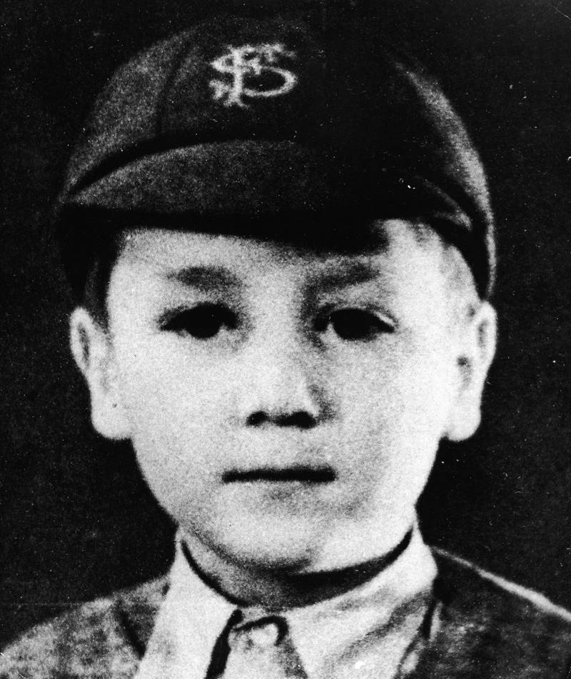 Headshot portrait of British musician and songwriter John Lennon (1940 -1980), of the pop group The Beatles, as a young boy in a school uniform and cap, circa 1948. (Photo by Pictorial Press/Getty Images)