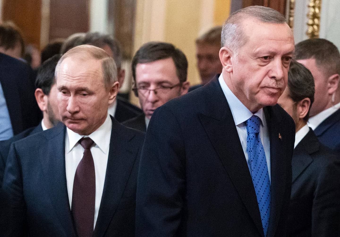 Russian President Vladimir Putin, left, and Turkish President Recep Tayyip Erdogan arrive for a news conference after their talks in the Kremlin, in Moscow, Russia, Thursday, March 5, 2020.  Russian President Vladimir Putin and his Turkish counterpart, Recep Tayyip Erdogan, say they have reached agreements that could end fighting in northwestern Syria. (AP Photo/Pavel Golovkin, Pool)