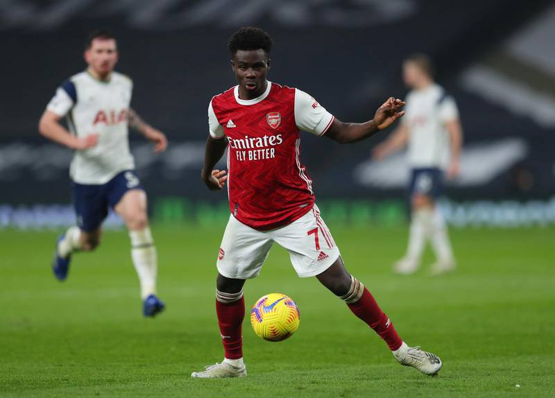 LONDON, ENGLAND - DECEMBER 06: Bukayo Saka of Arsenal  during the Premier League match between Tottenham Hotspur and Arsenal at Tottenham Hotspur Stadium on December 06, 2020 in London, England. A limited number of fans are welcomed back to stadiums to watch elite football across England. This was following easing of restrictions on spectators in tiers one and two areas only. (Photo by Catherine Ivill/Getty Images)