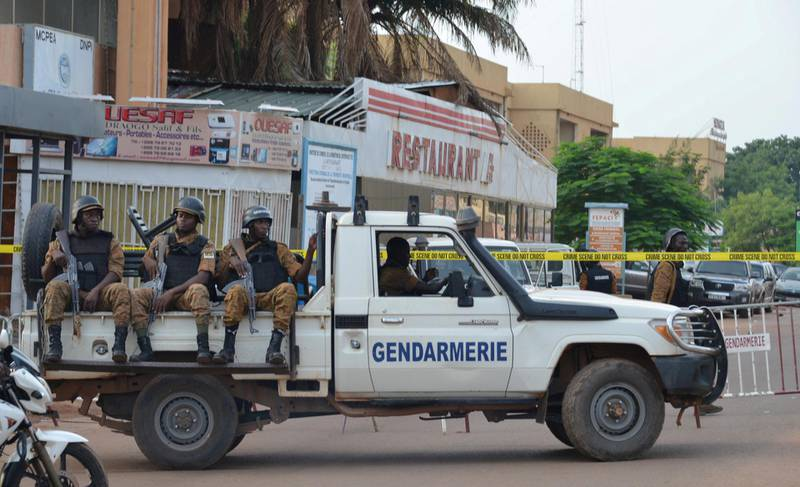 FILE PHOTO: Security forces deploy to secure the area after an overnight attack on a restaurant in the Burkina Faso capital Ouagadougou, August 14, 2017. REUTERS/Hamany Daniex/File Photo