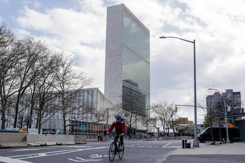 A cyclist passes the United Nations headquarters Thursday, April 16, 2020, in New York. New York planned for a long fight against the coronavirus outbreak amid hopeful hospitalization trends. Gov. Andrew Cuomo extended stay-at-home restrictions Thursday through mid-May and New York City is getting ready to use 11,000 empty hotel rooms for coronavirus quarantines. (AP Photo/Frank Franklin II)
