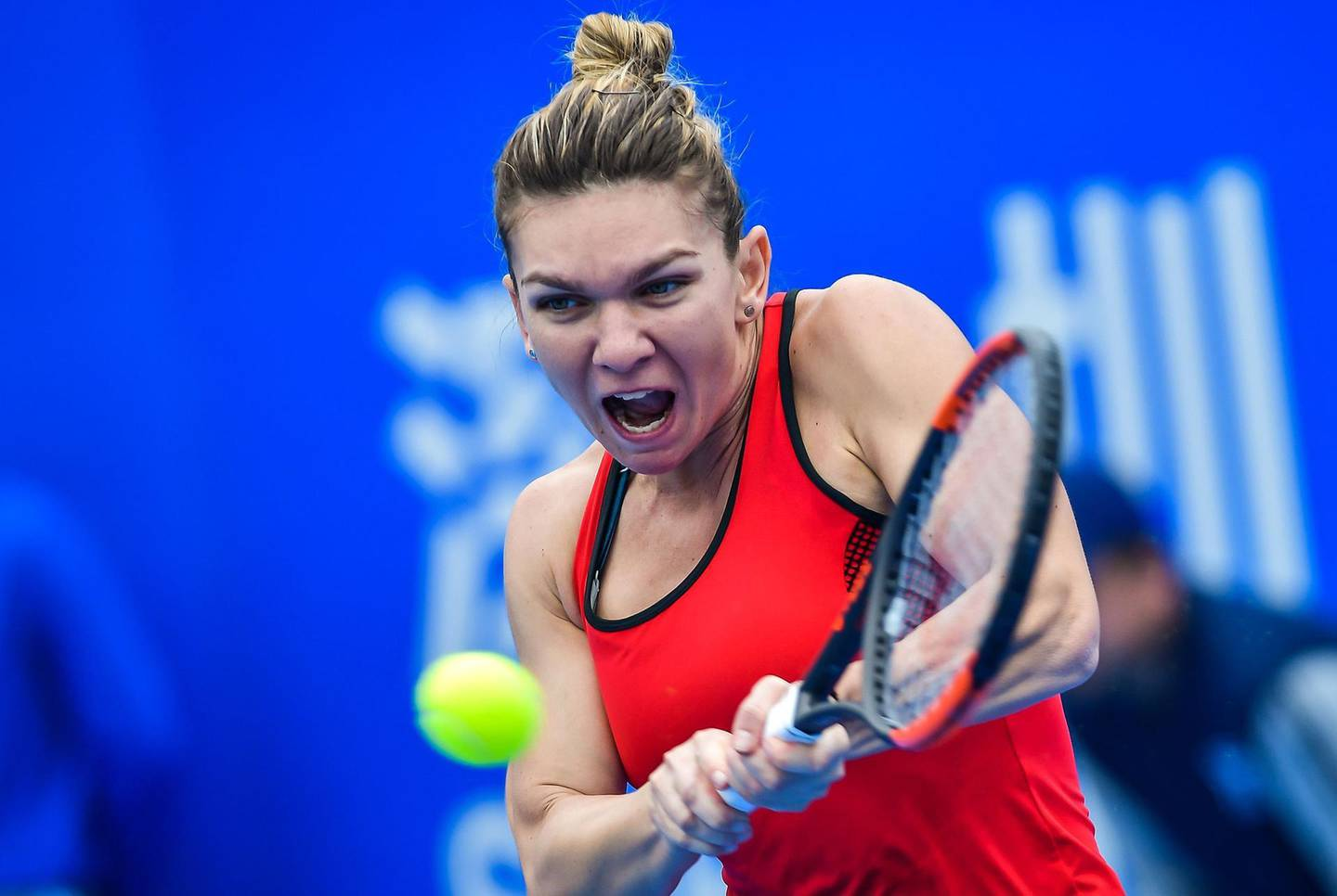 Simona Halep of Romania hits a return against Nicole Gibbs of the US in the first round of the Shenzhen Open tennis tournament in Shenzhen, in China's southern Guangdong province on January 1, 2018. / AFP PHOTO / - / China OUT