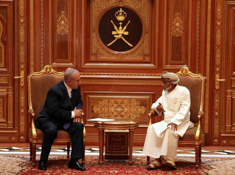 epa07121583 A handout photo made available by Israeli Prime Minister's office shows Sultan of Oman Qaboos bin Said Al Said (R) meeting with Israeli Prime Minister Benjamin Netanyahu (L), in Muscat, Oman, 26 October 2018. Reports state Netanyahu made an unannounced visit to Oman, an Arab country that has no diplomatic ties with Israel, where he had talks with Sultan Qaboos on the peace process in the Middle East as well as several matters of joint interest.  EPA/ISRAELI PRIME MINISTER OFFICE HANDOUT  HANDOUT EDITORIAL USE ONLY/NO SALES