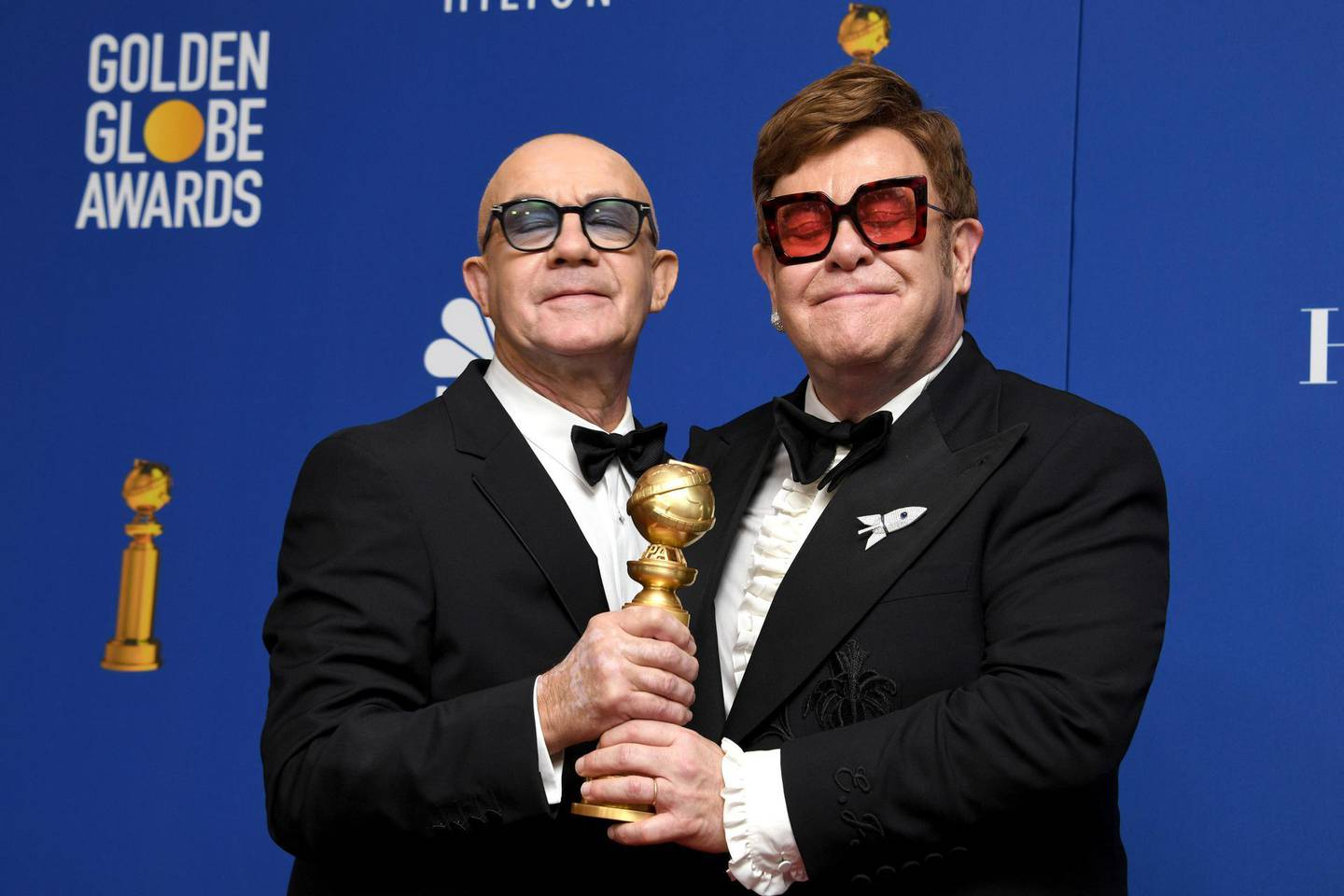 """epa08106195 Bernie Taupin (L) and Elton John, winners for the award for Best Original Song - Motion Picture for """"I'm Gonna Love Me Again"""" from """"Rocketman"""" in the press room during the 77th annual Golden Globe Awards ceremony at the Beverly Hilton Hotel, in Beverly Hills, California, USA, 05 January 2020.  EPA/CHRISTIAN MONTERROSA"""
