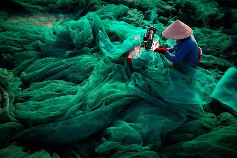 Tran Tuan Viet - Sewing Net (Phu Yen, Vietnam)As fish stocks decrease fishing methods become increasingly extreme. Destructive fishing with small hole net devastate the marine environment.