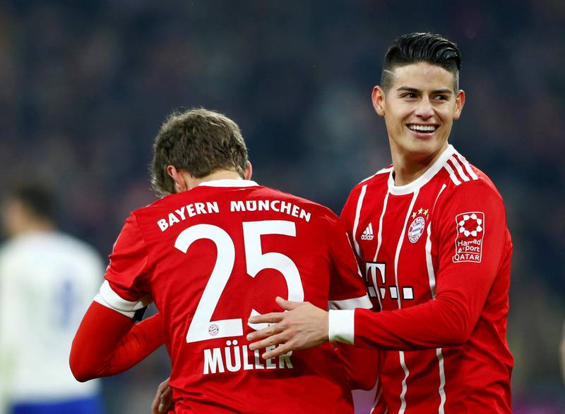 Soccer Football - Bundesliga - Bayern Munich vs Schalke 04 - Allianz Arena, Munich, Germany - February 10, 2018   Bayern Munich's Thomas Muller celebrates scoring their second goal with James Rodriguez    REUTERS/Michaela Rehle    DFL RULES TO LIMIT THE ONLINE USAGE DURING MATCH TIME TO 15 PICTURES PER GAME. IMAGE SEQUENCES TO SIMULATE VIDEO IS NOT ALLOWED AT ANY TIME. FOR FURTHER QUERIES PLEASE CONTACT DFL DIRECTLY AT + 49 69 650050