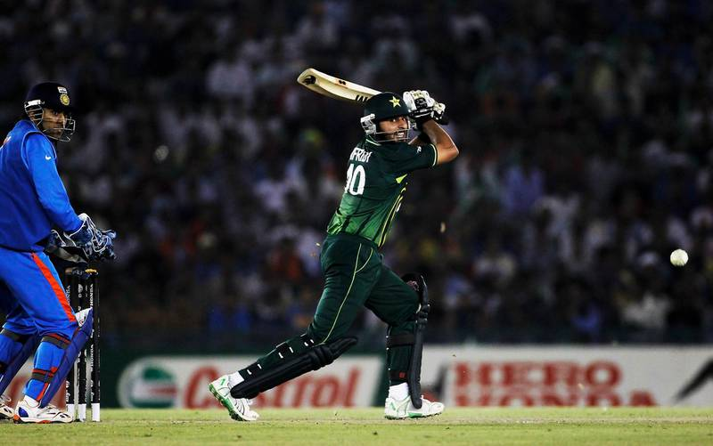 MOHALI, INDIA - MARCH 30: Captain Shahid Afridi of Pakistan bats as captain MS Dhoni of India looks on during the 2011 ICC World Cup second Semi-Final between India and Pakistan at Punjab Cricket Association (PCA) Stadium on March 30, 2011 in Mohali, India. (Photo by Daniel Berehulak/Getty Images)