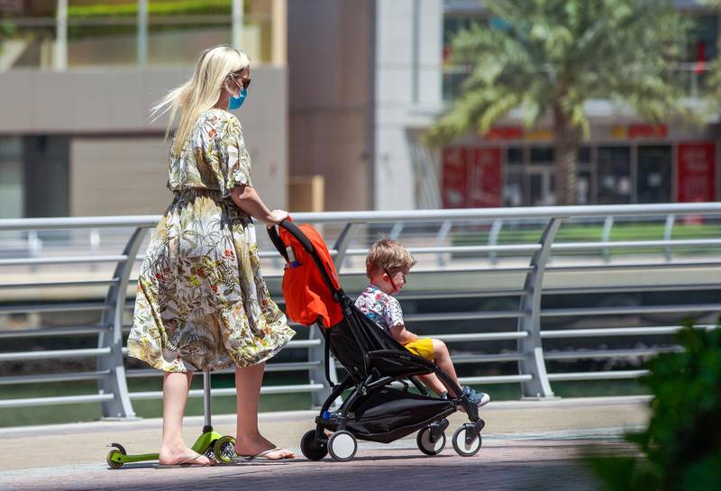 Dubai, United Arab Emirates, May 12, 2020.   Dubai Marina residents on a sunny morning.  A child on a stroller without a face mask during the coronavirus pandemic.Victor Besa / The NationalSection:  NAReporter:
