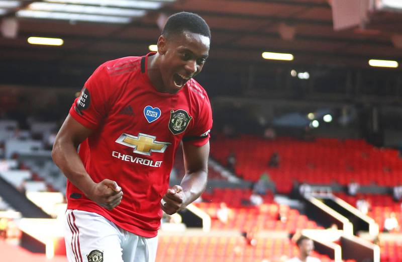 """Soccer Football - Premier League - Manchester United v Sheffield United - Old Trafford, Manchester, Britain - June 24, 2020  Manchester United's Anthony Martial celebrates scoring their third goal to complete his hat-trick, as play resumes behind closed doors following the outbreak of the coronavirus disease (COVID-19) Michael Steele/Pool via REUTERS  EDITORIAL USE ONLY. No use with unauthorized audio, video, data, fixture lists, club/league logos or """"live"""" services. Online in-match use limited to 75 images, no video emulation. No use in betting, games or single club/league/player publications.  Please contact your account representative for further details."""