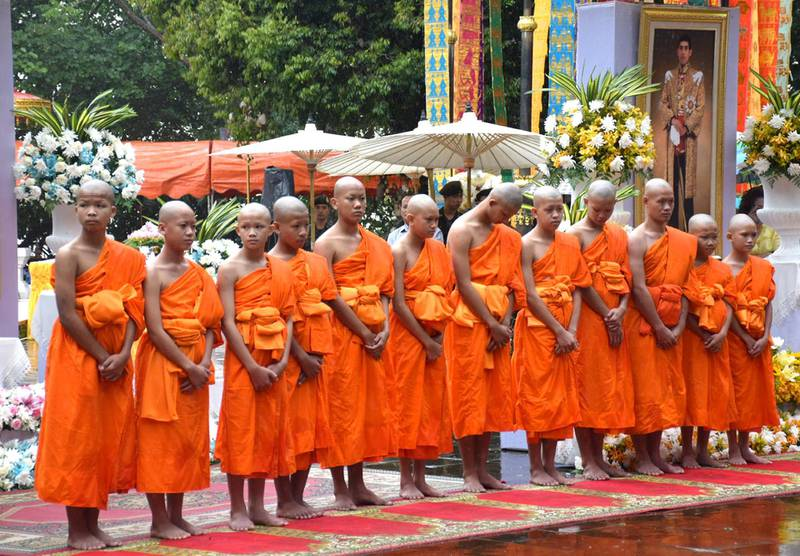 epa06908914 Members of the Wild Boars soccer team, who were rescued from Tham Luang cave, pose for photographs after their participation in a Buddhist novice monk ordination ceremony at Wat Phra That Doi Wao temple in Mae Sai district, Chiang Rai province, Thailand, 25 July 2018. The thirteen members of Wild Boar child soccer team, including their assistant coach, were safely rescued after being trapped in Tham Luang cave since 23 June 2018.  EPA/CHAICHAN CHAIMUN