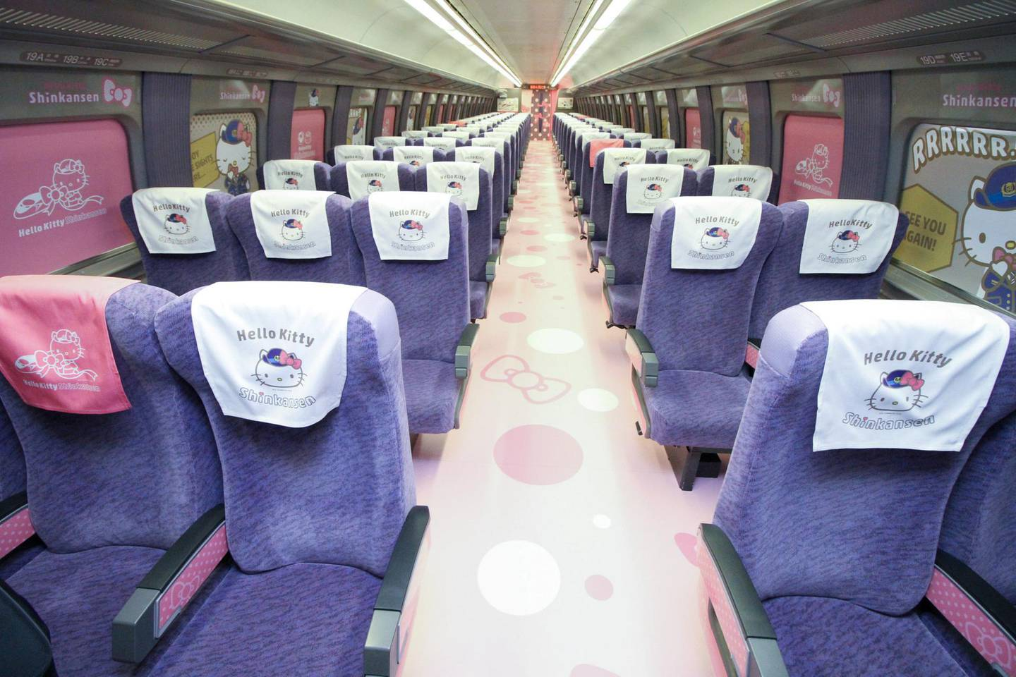 """This handout picture taken on June 25, 2018 and released by West Japan Railway on June 26, 2018 shows the interior of a Shinkansen train adorned with images of popular character Hello Kitty, at the Hakata car maintenance center in Fukuoka prefecture. Resplendent in shocking pink, a sleek """"Hello Kitty"""" bullet train, complete with special carriages festooned with images of the global icon from Japan, has been unveiled before chugging into service this week starting June 25. / AFP PHOTO / West Japan Railway / Handout / -----EDITORS NOTE --- RESTRICTED TO EDITORIAL USE - MANDATORY CREDIT """"AFP PHOTO / West Japan Railway"""" - NO MARKETING - NO ADVERTISING CAMPAIGNS - DISTRIBUTED AS A SERVICE TO CLIENTS - NO ARCHIVES"""