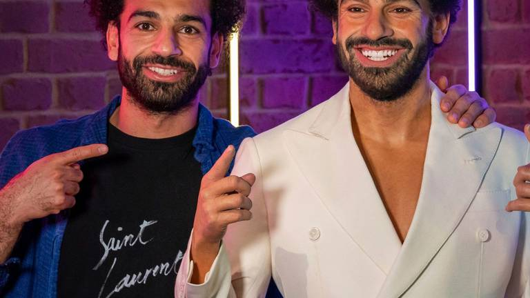An image that illustrates this article Seeing double? Mo Salah unveils wax doppelganger at Madame Tussauds