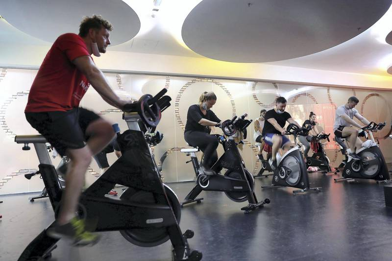 DUBAI, UNITED ARAB EMIRATES , August 10 – 2020 :- Participants during the cycling session at the UFC Gym in Murjan 6 in Jumeirah Beach Residence in Dubai. They are taking part in the 90 minutes MMA Mash up. (Pawan Singh / The National) For News/Online/Instagram. Story by Nick Webster