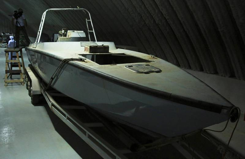 """FILE - In this June 19, 2018 file photo, a boat that officials described as being a """"drone boat"""" once loaded with explosives by Shiite rebels in Yemen, is on display at a military installation in the United Arab Emirates. Iran-backed Houthi rebels increasingly deploy drones in Yemen's brutal civil war. Neighboring Saudi Arabia, which has been battling the rebels since 2015, said drones attacked an oil pipeline, targeting two pumping stations west of its capital, Riyadh, on Tuesday, May 14, 2019. (AP Photo/Jon Gambrell, File)"""