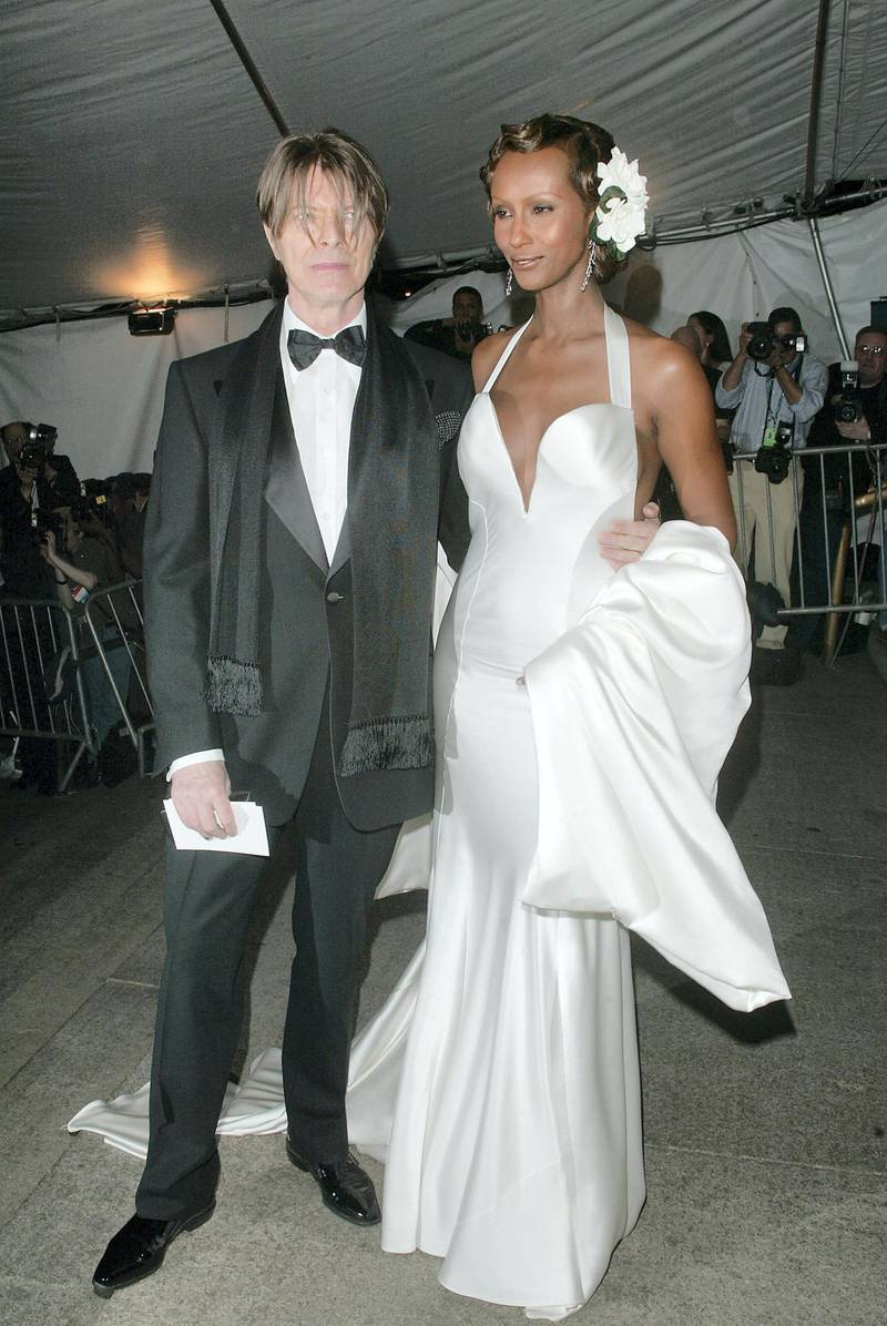 NEW YORK - APRIL 28:  (US TABS AND HOLLYWOOD REPORTER OUT) Musician David Bowie and wife model Iman arrive at the Metropolitan Museum of Art Costume Institute Benefit Gala sponsored by Gucci April 28, 2003 at The Metropolitan Museum of Art in New York City. (Photo by Evan Agostini/Getty Images)
