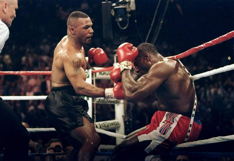 LAS VEGAS - MARCH 16:  (FILE PHOTO) Mike Tyson throws a punch at Frank Bruno during a fight at the MGM on March 16, 1996 in Las Vegas, Nevada.  On September 22, 2003, the former world heavyweight boxing champion was taken to psychiatric hospital for treatment.  It has been reported that Bruno was seeking help for depression as he struggled to come to terms with life outside the ring and a divorce.  (Photo by Al Bello/Getty Images)