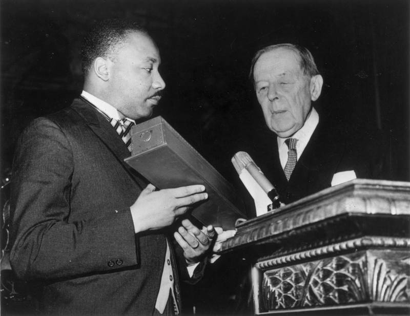 10th December 1964:  American civil rights leader Martin Luther King (1929  - 1968) (left) receives the Nobel Prize for Peace from Gunnar Jahn, president of the Nobel Prize Committee, in Oslo.  (Photo by Keystone/Getty Images)