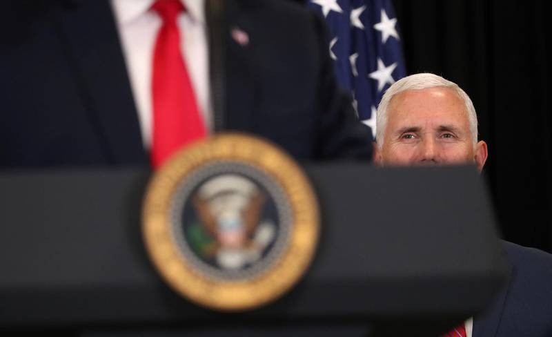 U.S. President Donald Trump is watched by Vice President Mike Pence as they take part in the swearing-in ceremony for the Central Intelligence Agency's first female director, Gina Haspel, at CIA Headquarters in Langley, Virginia, U.S., May 21, 2018. REUTERS/Kevin Lamarque