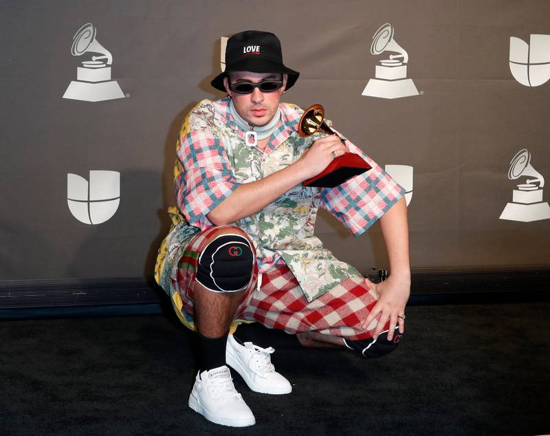epa07997731 Bad Bunny poses with the Best Urban Music Album award in the press room during the 20th annual Latin Grammy Awards ceremony at the MGM Grand Garden Arena in Las Vegas, Nevada, USA, 14 November 2019. The Latin Grammys recognize artistic and/or technical achievement, not sales figures or chart positions, and the winners are determined by the votes of their peers - the qualified voting members of the Latin Recording Academy.  EPA-EFE/NINA PROMMER