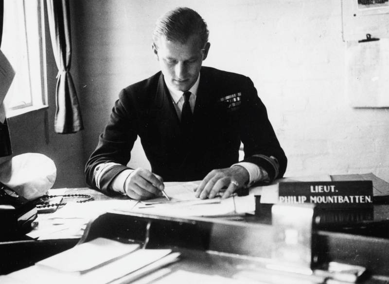 Lieutenant Philip Mountbatten, prior to his marriage to Princess Elizabeth, working at his desk after returning to his Royal Navy duties at the Petty Officers Training Centre in Corsham, Wiltshire, August 1st 1947. (Photo by Douglas Miller/Keystone/Getty Images)