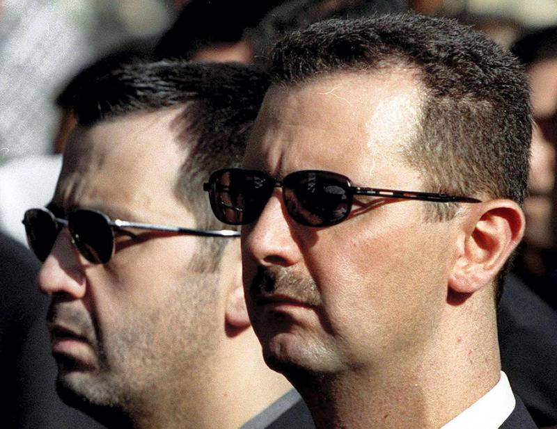 TO GO WITH STORY BY NATACHA YAZBECK (FILES) A picture dated June 13, 2003 shows Syrian President Bashar al-Assad and his brother Maher (L) attending their father's funeral in Damascus on June 13, 2000. As Bashar al-Assad's regime fights to stay in power, one man has emerged as the symbol of the dynasty's brutal military might -- the president's feared younger brother Maher. AFP PHOTO/RAMZI HAIDAR (Photo by RAMZI HAIDAR / AFP)