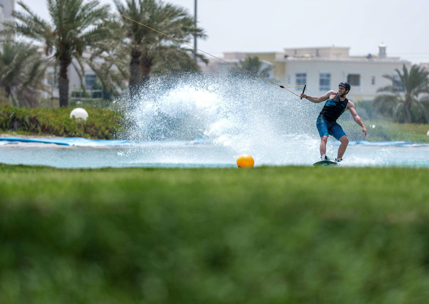 Abu Dhabi, United Arab Emirates, June 21, 2019.  Weather images.  Beating the heat at Al Forsan wakeboarding cable park. --  Rob Dam in action.Victor Besa/The NationalSection:  NAReporter: