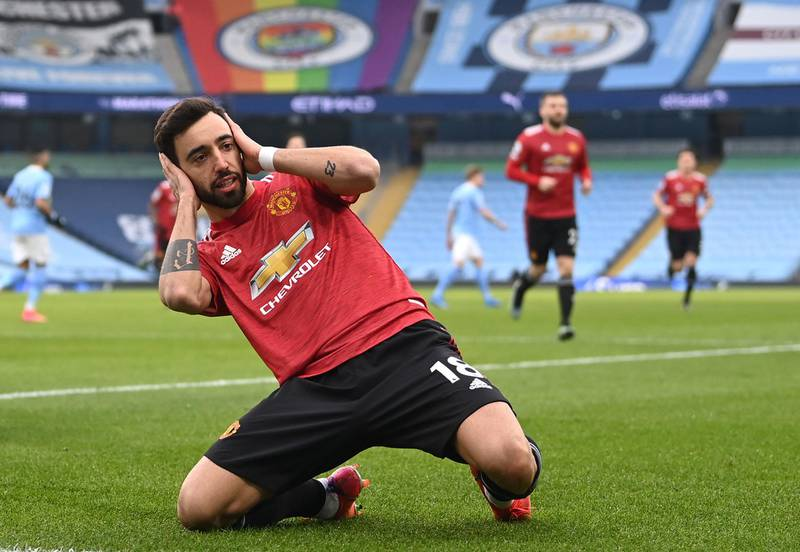 """Manchester United's Bruno Fernandes celebrates scoring their side's first goal of the game during the Premier League match at the Etihad Stadium, Manchester. Picture date: Sunday March 7, 2021. PA Photo. See PA story SOCCER Man City. Photo credit should read: Laurence Griffiths/PA Wire.RESTRICTIONS: EDITORIAL USE ONLY No use with unauthorised audio, video, data, fixture lists, club/league logos or """"live"""" services. Online in-match use limited to 120 images, no video emulation. No use in betting, games or single club/league/player publications."""