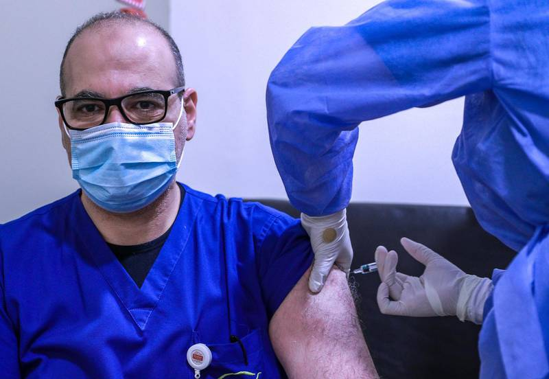 Abu Dhabi, United Arab Emirates, December 13, 2020.   Doctors and UAE residents get Covid-19 vaccinated at the Burjeel Hospital, Al Najdah Street, Abu Dhabi.  Dr. Ayman Mohamed Abdelhady gets vaccinated.Victor Besa/The NationalSection:  NA
