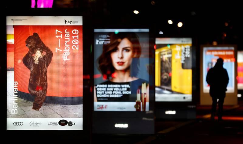 A pedestrian walks past advertising billboards for the upcoming Berlin International Film Festival Berlinale in Berlin, Germany, February 5, 2019.    REUTERS/Fabrizio Bensch