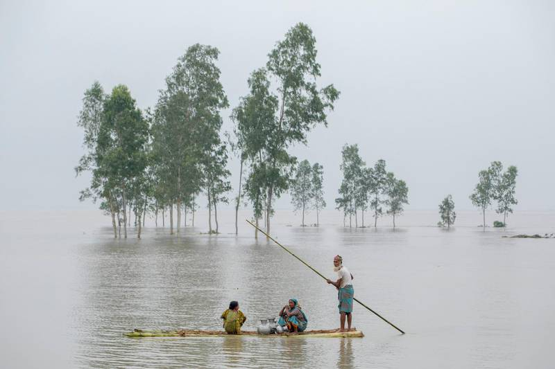 People transporting fresh water in a banana boat during flooding in the Kajla area at Bogra, Bangladesh 16 August 2017. Peoples suffering continues as many of them left their homes along with their cattle, goats, hens and other pets and took shelter in safe areas and many of these people have still not been able to return as the water has not fully receded from their homes. Flood-related incidents in Dinajpur, Gaibandha and Lalmonirhat has seen the death toll rise to 30 in the last three days across the country.