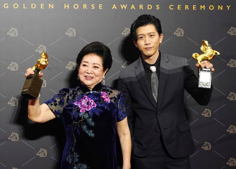 Taiwanese actors Chen Shu-fang, left, and Mo Tzu-yi hold their awards for Best Leading Actress and Best Leading Actor at the 57th Golden Horse Awards in Taipei, Taiwan, Saturday, Nov. 21, 2020. Golden Horse Awards is considered Asia's equivalent of the Academy Awards for Chinese-language films. (AP Photo/Billy Dai)