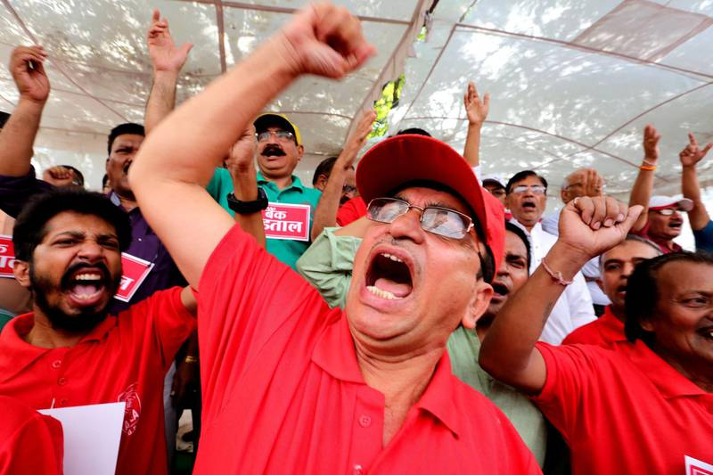 epa06772295 Indian bank employees shout slogans as they take part in a protest during the nationwide strike call given by the United Forum of Bank Unions (UFBU) in Bhopal, India, 30 May 2018. Banking services were hit as around one million bank employees went on a strike for two days as tp protest against a 'meagre' two percent salary hike planned by the Indian Banks' Association (IBA).  EPA/SANJEEV GUPTA