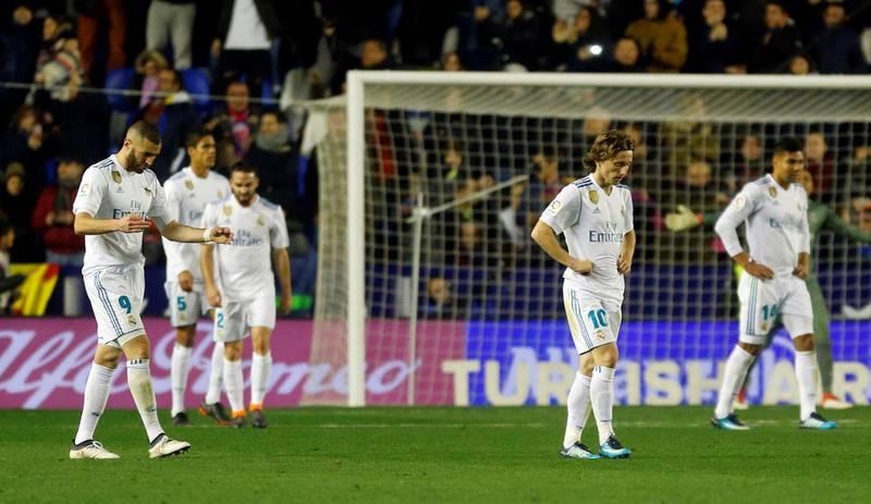 Soccer Football - La Liga Santander - Levante vs Real Madrid - Ciutat de Valencia, Valencia, Spain - February 3, 2018   Real Madrid's Luka Modric, Karim Benzema and team mates look dejected after Levante's second goal   REUTERS/Heino Kalis