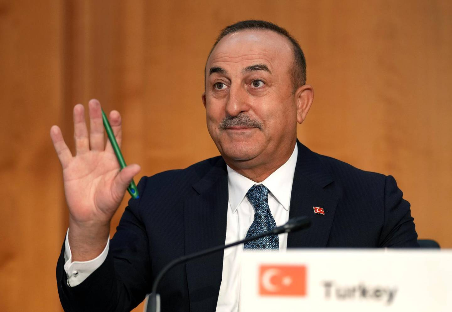 Turkey's Foreign Minister Mevlut Cavusoglu waves during the 'Second Berlin Conference on Libya' at the foreign office in Berlin, Germany, Wednesday, June 23, 2021. (AP Photo/Michael Sohn, pool)