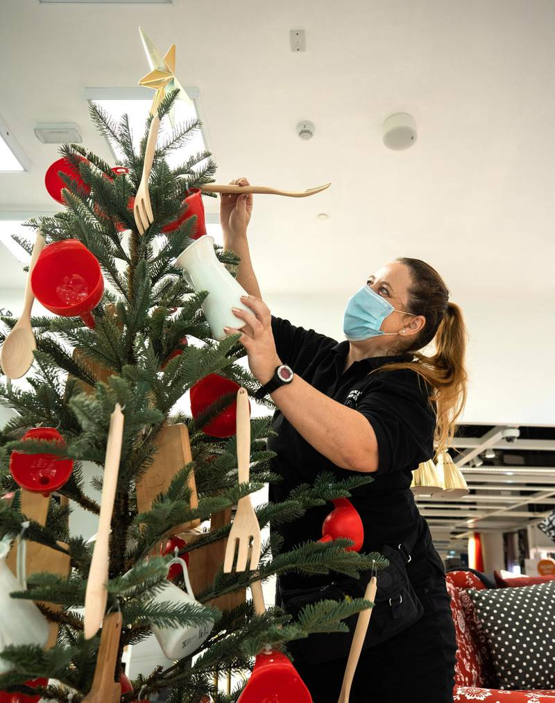 Abu Dhabi, United Arab Emirates, November 8, 2020.   A first look at the IKEA store at Al Wahda Mall before the opening on Tuesday, November 10.  Elaine of the IKEA expansion team puts up the IKEA Christmas tree.Victor Besa/The NationalSection:  LFReporter:  Farah Andrews