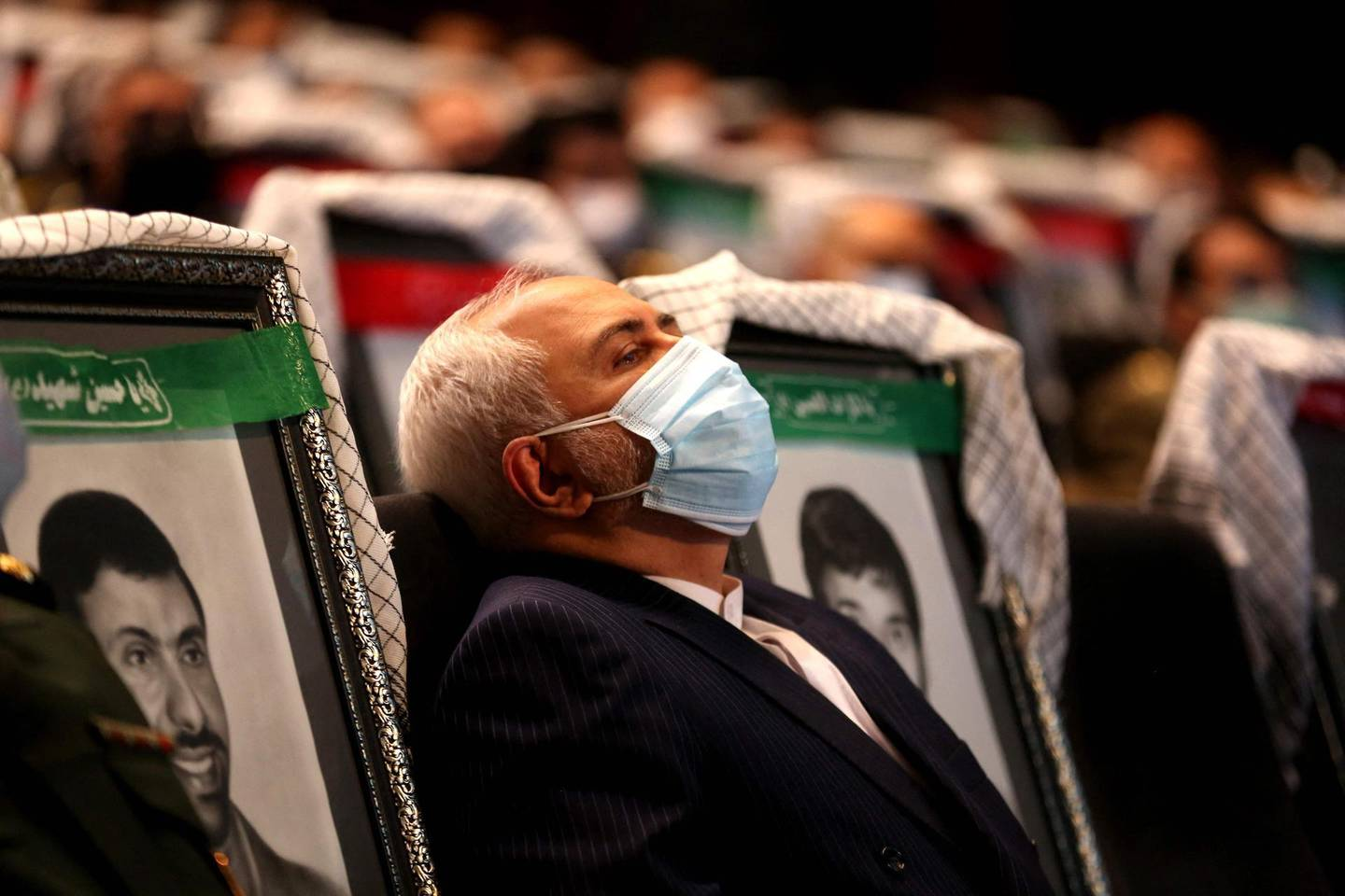 Iranian Foreign Minister Mohammad Javad Zarif listens to a speach during the the International Conference on the Legal-International Claims of the Holy Defense in the capital Tehran on February 23, 2021.  / AFP / ATTA KENARE