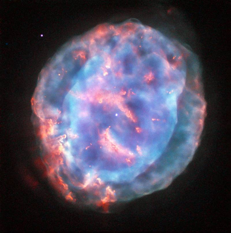 This colourful bubble is a planetary nebula called NGC 6818, also known as the Little Gem Nebula. It is located in the constellation of Sagittarius (The Archer), roughly 6000 light-years away from us. NASA