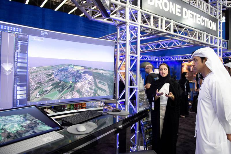 ABU DHABI, UNITED ARAB EMIRATES - February 17, 2019: HH Sheikh Hazza bin Zayed Al Nahyan, Vice Chairman of the Abu Dhabi Executive Council (L), inspects  tours the 2019 International Defence Exhibition and Conference (IDEX), at Abu Dhabi National Exhibition Centre (ADNEC).  ( Saeed Al Neyadi / Ministry of Presidential Affairs ) ---