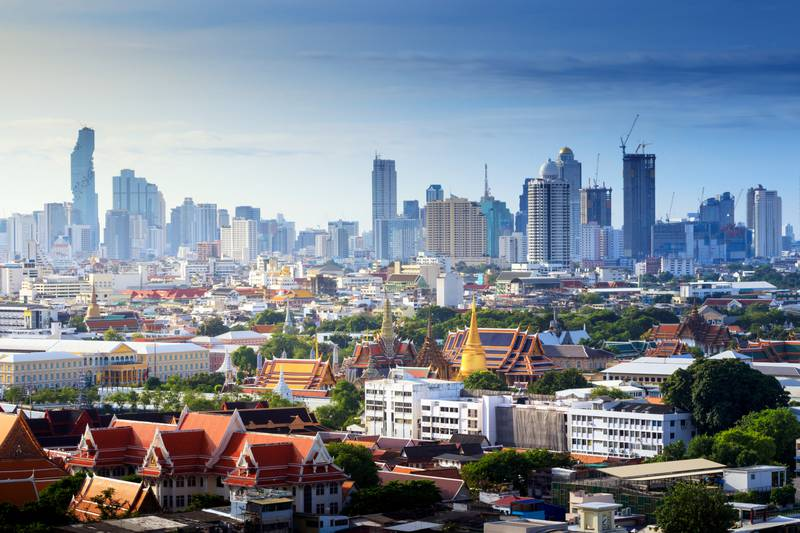 Grand palace and Wat phra keaw and Bangkok Cityscape, Business district with sunrise at bangkok ,Thailand. Temple of the Emerald Buddha. landscape of the capital city