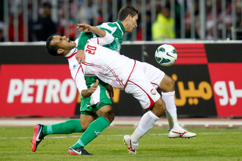 UAE's Ali Salem (R) and Iraq's Ali Adnan Al Tameemi fight for the ball during their final game at the Gulf Cup Tournament in Isa Town, January 18, 2013. REUTERS/Mohammed Dabbous (BAHRAIN - Tags: SPORT SOCCER) *** Local Caption ***  BAH24D_SOCCER-_0118_11.JPG