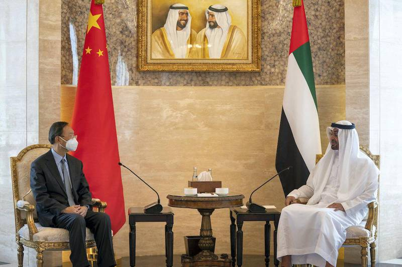 ABU DHABI, UNITED ARAB EMIRATES - October 10, 2020: HH Sheikh Mohamed bin Zayed Al Nahyan, Crown Prince of Abu Dhabi and Deputy Supreme Commander of the UAE Armed Forces (R) meets with Yang Jiechi, Special Representative of the President of China and Member of the Political Bureau of the Central Committee of the Communist Party of China (L), at Al Shati Palace.  ( Eissa Al Hammadi for the Ministry of Presidential Affairs ) ---