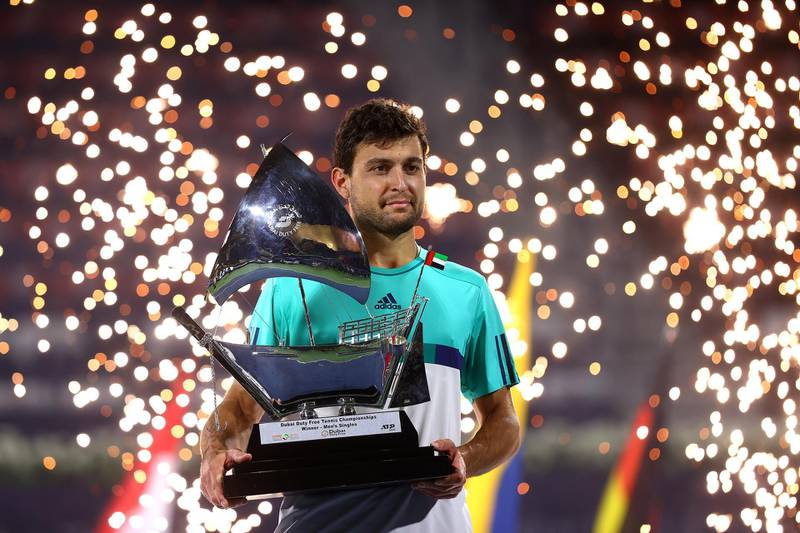 DUBAI, UNITED ARAB EMIRATES - MARCH 20:  Aslan Karatsev of Russia poses with the trophy after beating Lloyd Harris of South Africa to win the men's singles Final match during day fourteen of the Dubai Duty Free Tennis at Dubai Duty Free Tennis Stadium on March 20, 2021 in Dubai, United Arab Emirates. (Photo by Francois Nel/Getty Images)