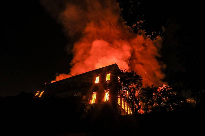RIO DE JANEIRO, BRAZIL - SEPTEMBER 02: A fire burns at the National Museum of Brazil on September 2, 2018 in Rio de Janeiro, Brazil. The museum, which is tied to the Rio de Janeiro federal university and the Education Ministry, was founded in 1818 by King John VI of Portugal. It houses several landmark collections including Egyptian artefacts and the oldest human fossil found in Brazil.  Its collection include more than 20 million items ranging from archaeological findings to historical memorabilia. (Photo by Buda Mendes/Getty Images)