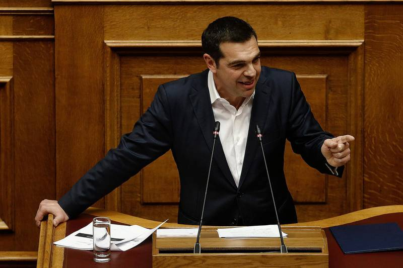 epa06551626 Greek Prime Minister Alexis Tsipras speaks during a debate in the plenary session of the Parliament in Athens, Greece, 21 February 2018. The Parliament debates prior to a vote late at night on whether two former prime ministers and another eight former ministers should be investigated by a preliminary committee for liability in the Novartis alleged bribery and money laundering case.  EPA/ALEXANDROS VLACHOS