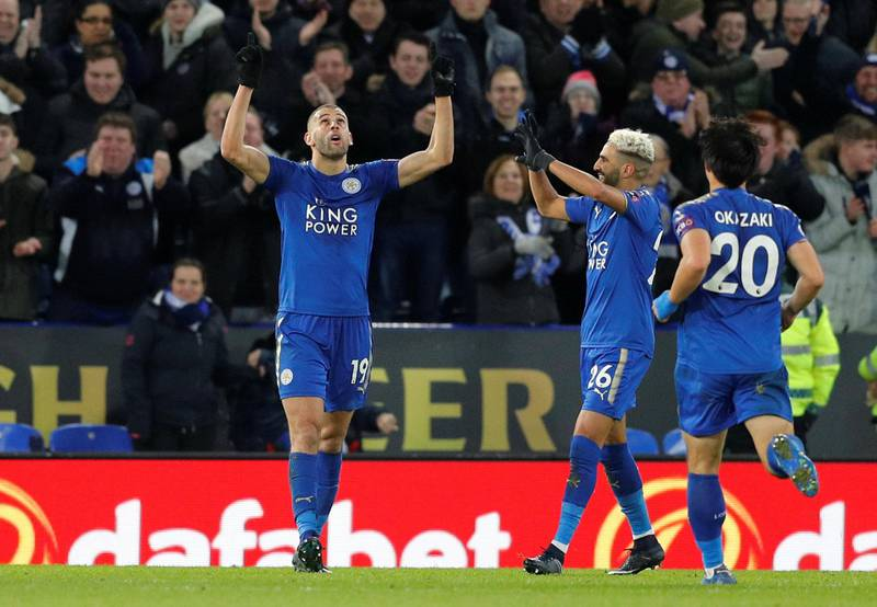 """Soccer Football - Premier League - Leicester City vs Huddersfield Town - King Power Stadium, Leicester, Britain - January 1, 2018   Leicester City's Islam Slimani celebrates scoring their second goal with team mates            REUTERS/Darren Staples    EDITORIAL USE ONLY. No use with unauthorized audio, video, data, fixture lists, club/league logos or """"live"""" services. Online in-match use limited to 75 images, no video emulation. No use in betting, games or single club/league/player publications.  Please contact your account representative for further details."""