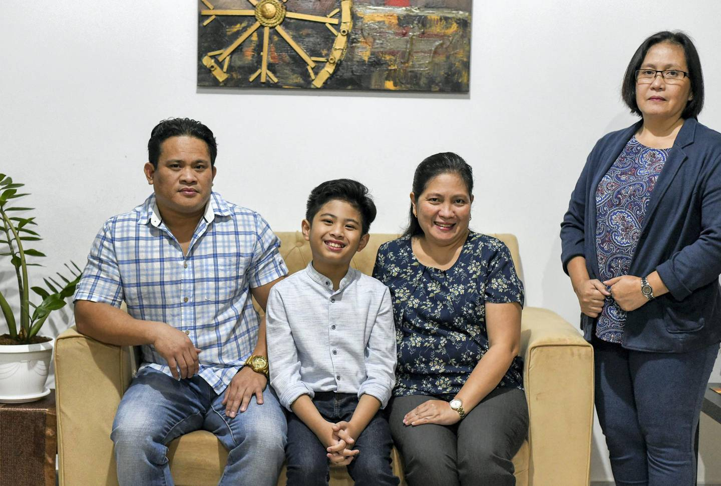 Peter Rosalita-AD  Peter Rosalita, 10, with his parents Ruel Rosalita, Vilma Villegas, and aunt Mary Jane Villegas in Abu Dhabi on June 7, 2021. Reporter: David Tusing Features