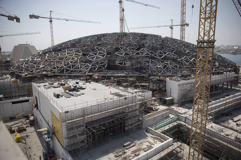 ABU DHABI, UNITED ARAB EMIRATES, Sep. 21, 2014:  The unique dome of Louvre Abu Dhabi is now missing only a couple of super-sized elements as seen on Sunday, Sep. 21, 2014, at the site on Saadiyat Island in Abu Dhabi.  With just over a year left for the completion of Louvre AbU Dhabi, work will be shifting from the construction of the large structures to further and further refining the future gallery into its final polished state.  (Silvia Razgova / The National)Usage: undated, RESTRICTEDSection: NAReporter: Nick Leech