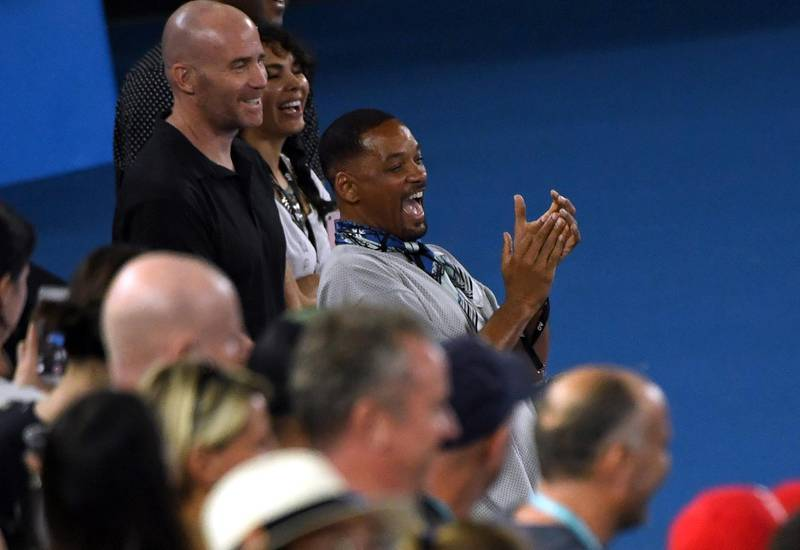 epa06453465 US actor Will Smith is acknowledged during a post match interview by Nick Kyrgios of Australia who defeated Jo-Wilfried Tsonga of France at the Australian Open tennis tournament in Melbourne, Victoria, Australia, 19 January 2018.  EPA/DEAN LEWINS  AUSTRALIA AND NEW ZEALAND OUT