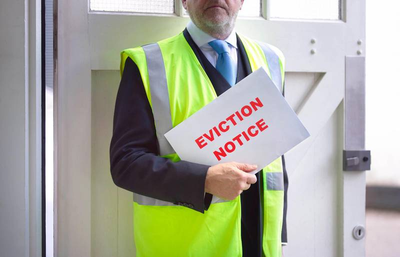 Eviction notice being delivered. Getty Images
